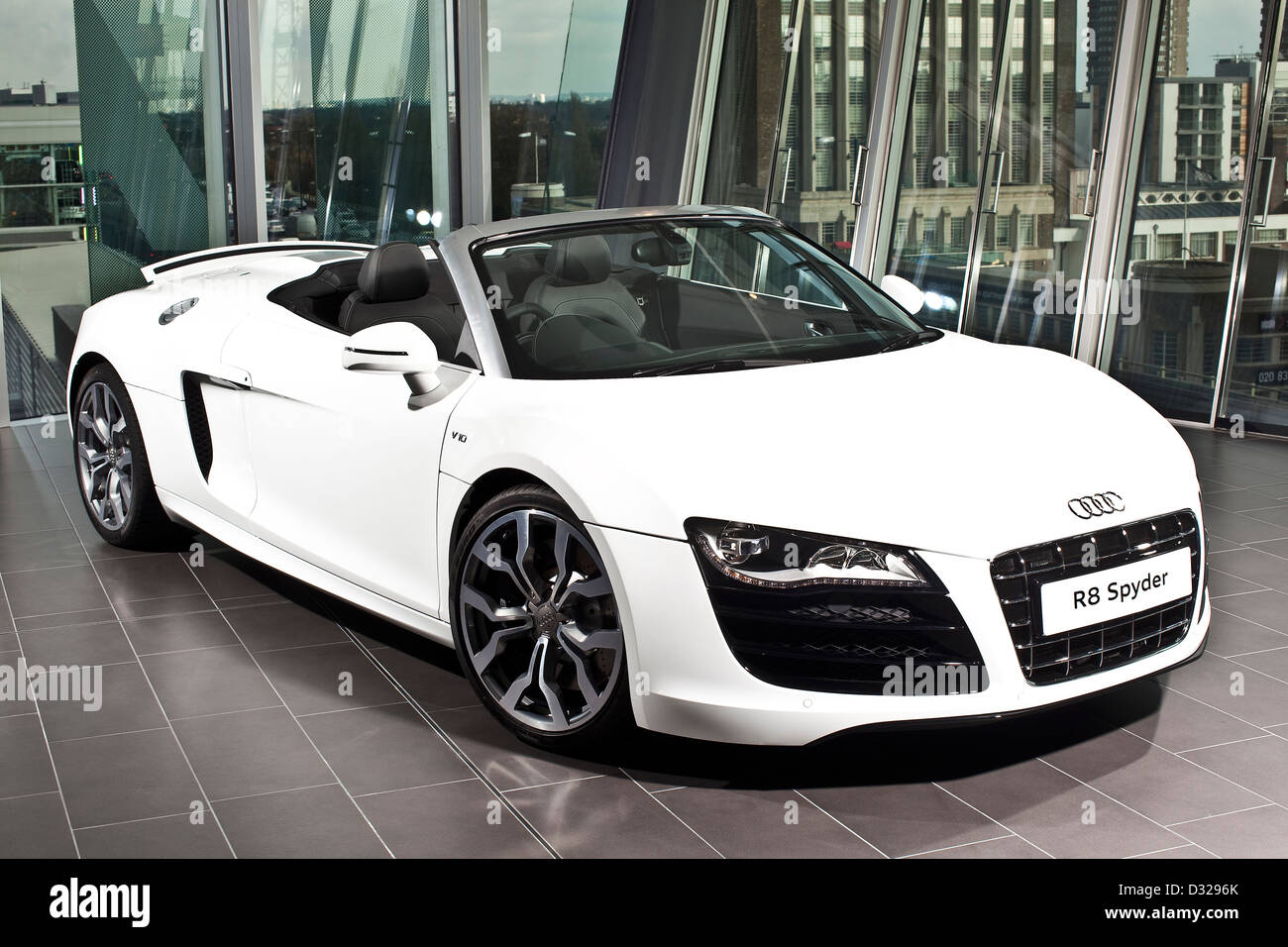 white audi r8 spyder in car showroom, richmond, england, uk stock