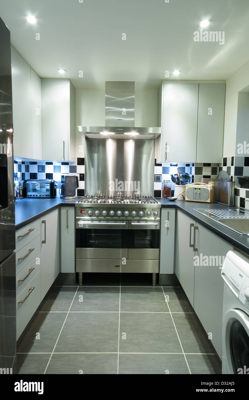 a small modern domestic kitchen with a stainless steel. Black Bedroom Furniture Sets. Home Design Ideas