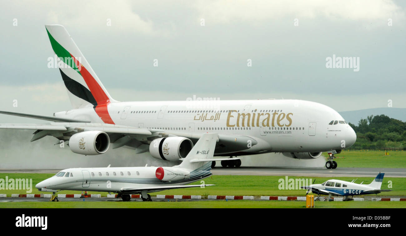 Emirates Airlines Airbus A380 861 E6 EDK Lands On A Wet Runway At Stock Photo