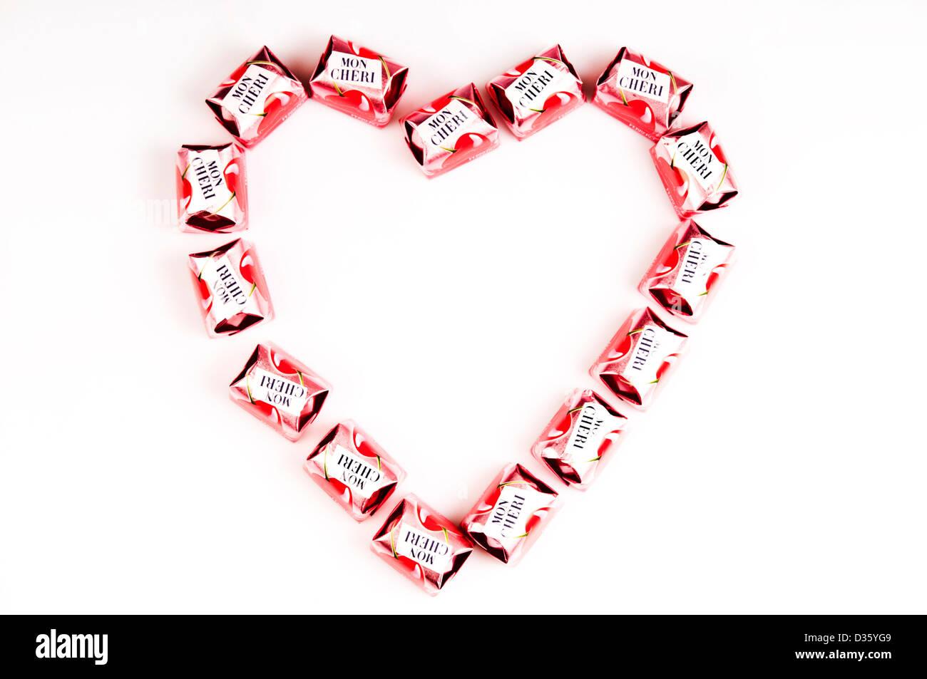 heart shape made with Mon Cheri chocolate bonbons Stock Photo ...