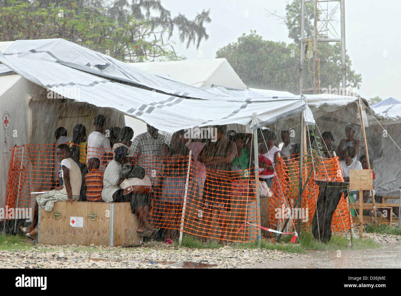 Carrefour Haiti patients under a tent covering the pharmacy of the Field Hospital & Carrefour Haiti patients under a tent covering the pharmacy of ...