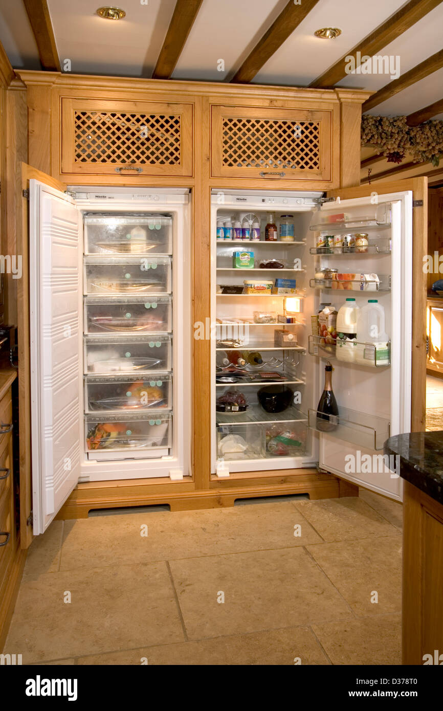 Stock Photo   Well Stocked Fridge Freezer In An Upmarket Solid Wood Fitted  Kitchen