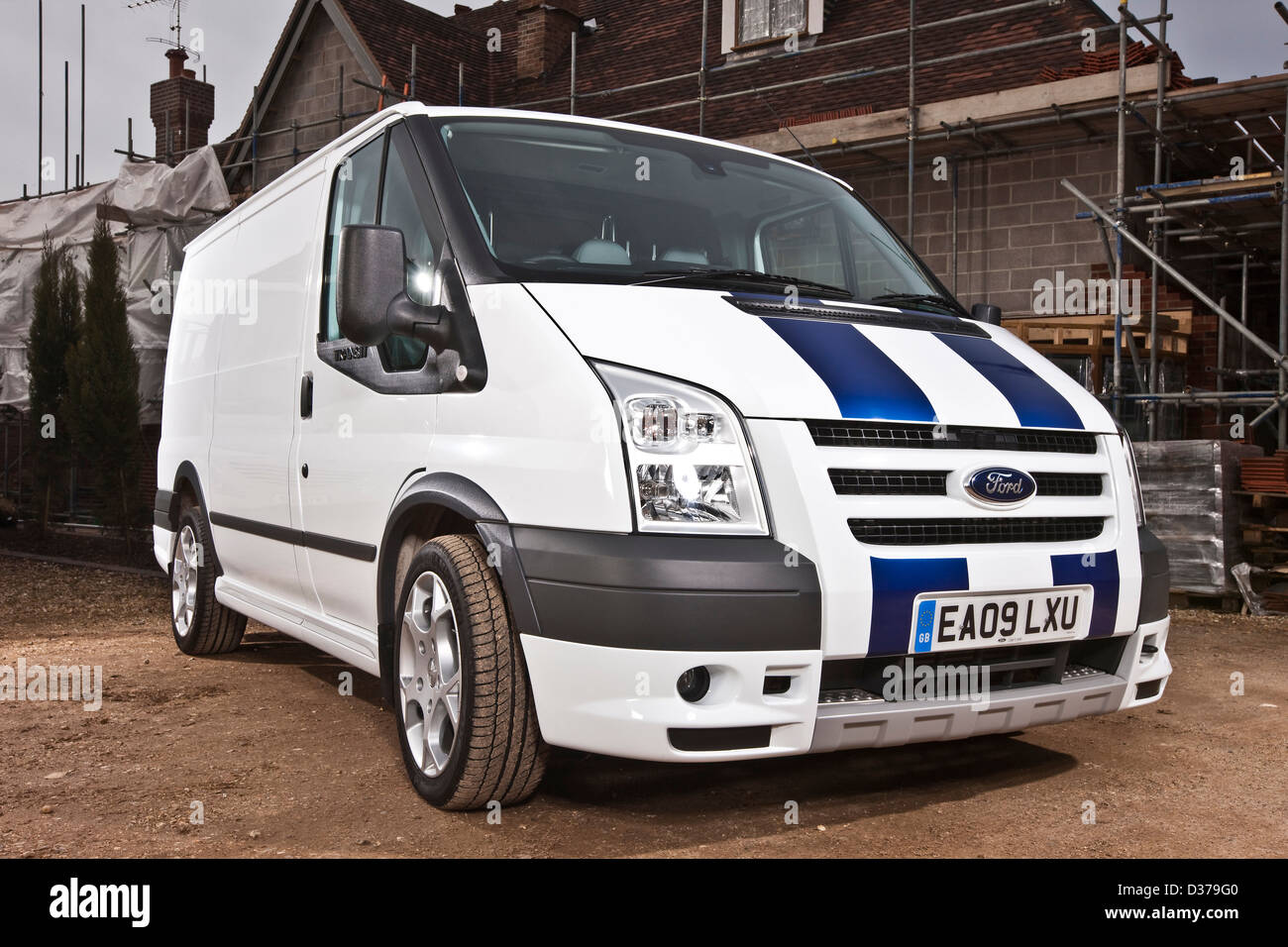 white ford transit sport van and building exterior with scaffolding stock photo royalty free. Black Bedroom Furniture Sets. Home Design Ideas