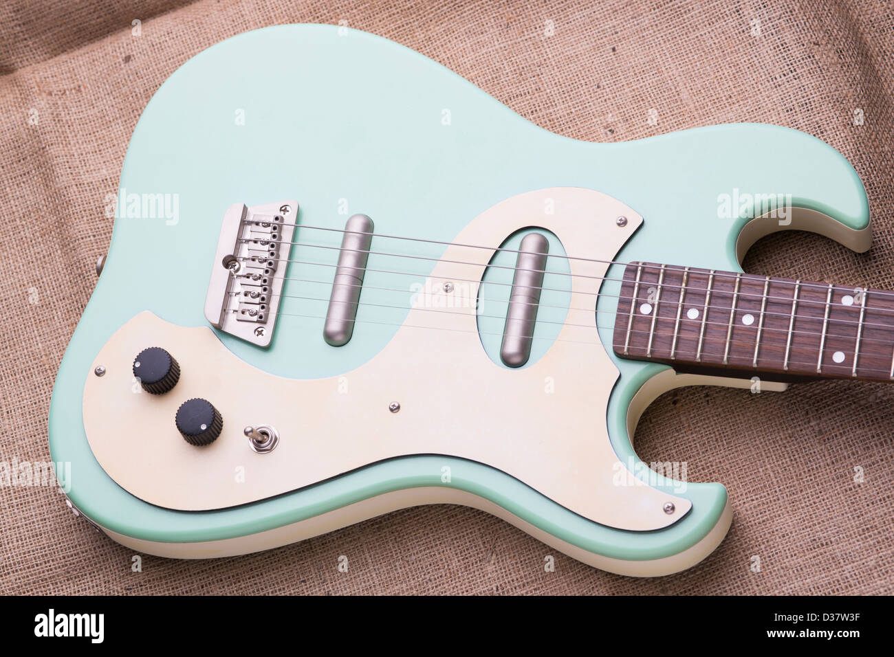 Danelectro Baby Blue Electric Guitar On A Hessian Sack With Soft Natural Lighting