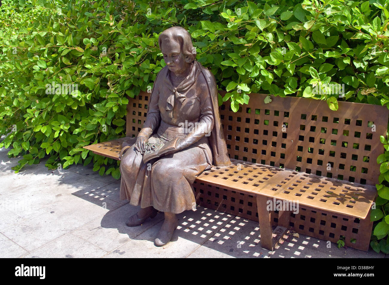 Bronze Statue Of A Woman Sitting On A Bench In The Triunfo