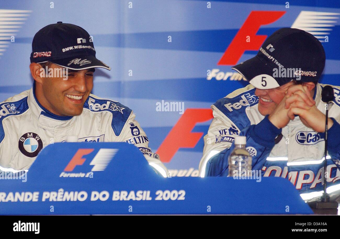 dpa juan pablo montoya l colombian formula 1 pilot and his german team mate ralf schumacher rejoicing over their positions they won during the