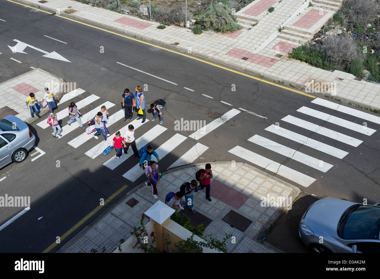 nursery school children being escorted across a pedestrian nursery school children being escorted across a pedestrian crossing by an adult supervisor aerial view