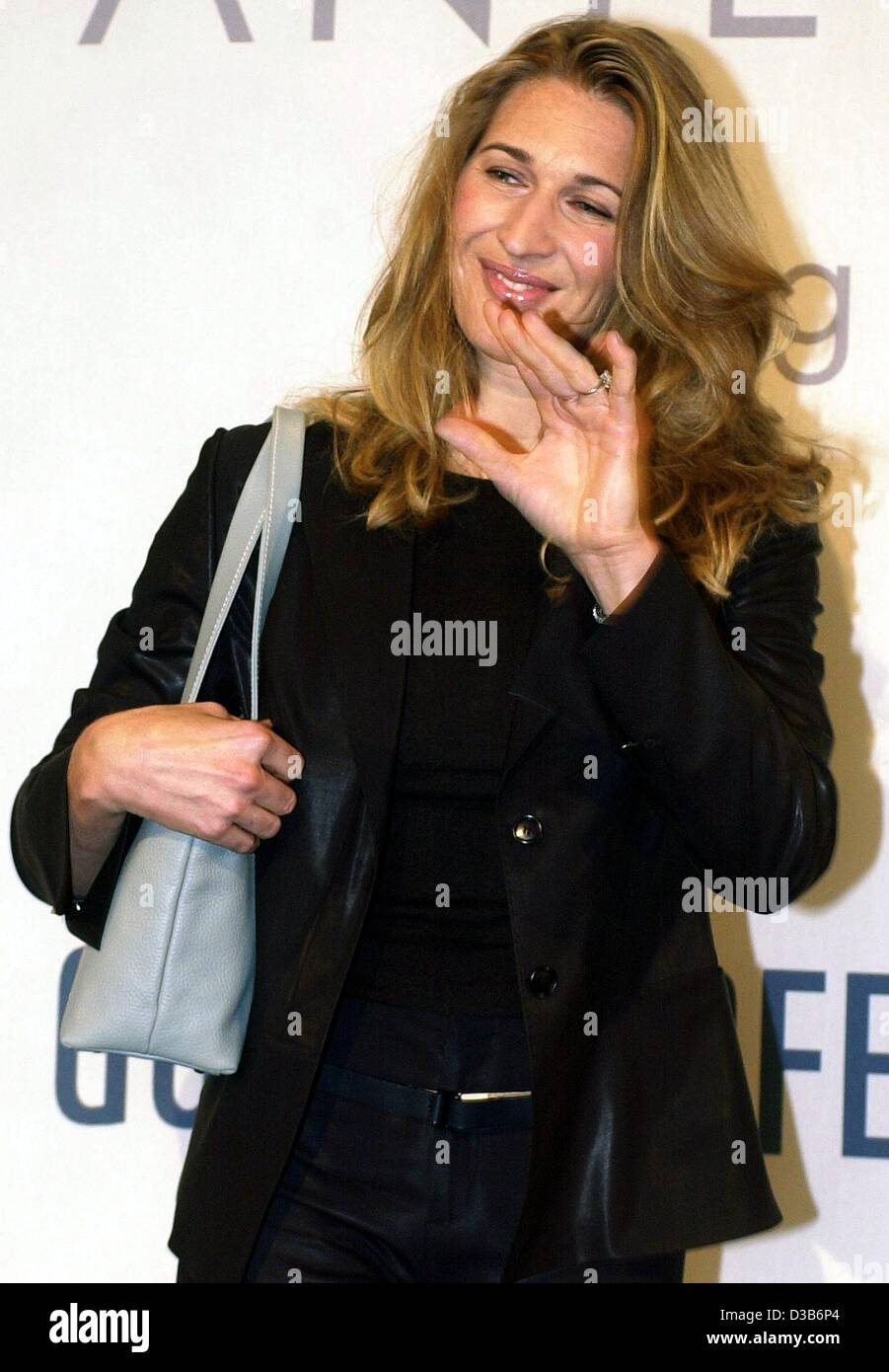 dpa German tennis star Steffi Graf waves at the end of her