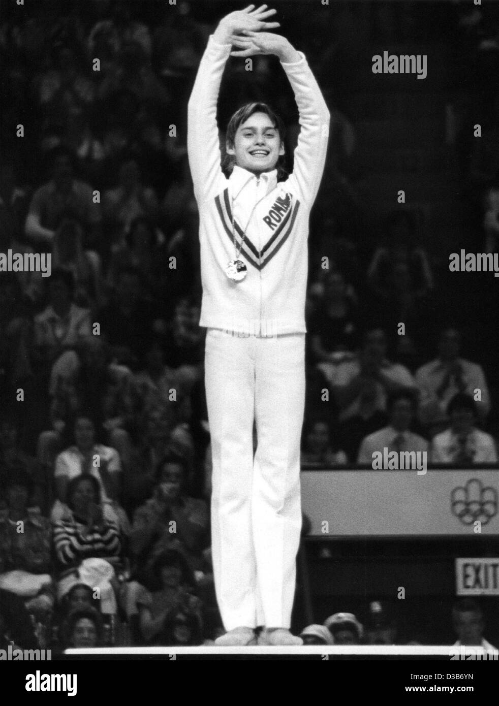 dpa files romanian gymnast nadia comaneci jubilates on the podium after winning the