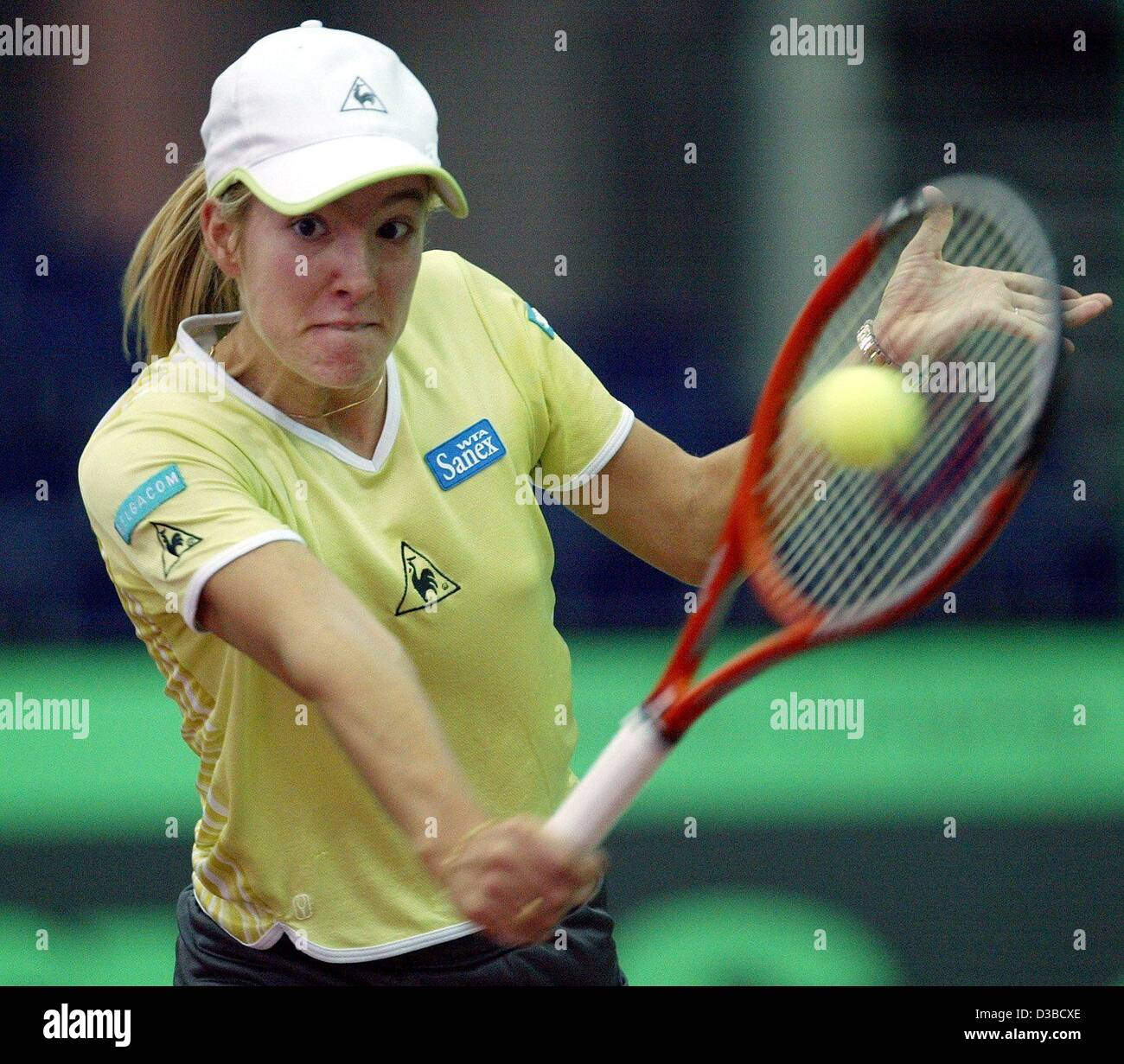 dpa Belgium s Justine Henin plays a backhand during the eighth