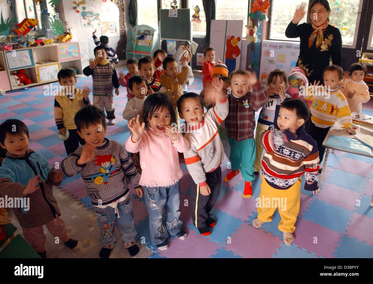 dpa small children and their teacher smile and wave at the sos childrens village in hanoi vietnam december 2004 four sos childrens villages opened - Small Childrens Images