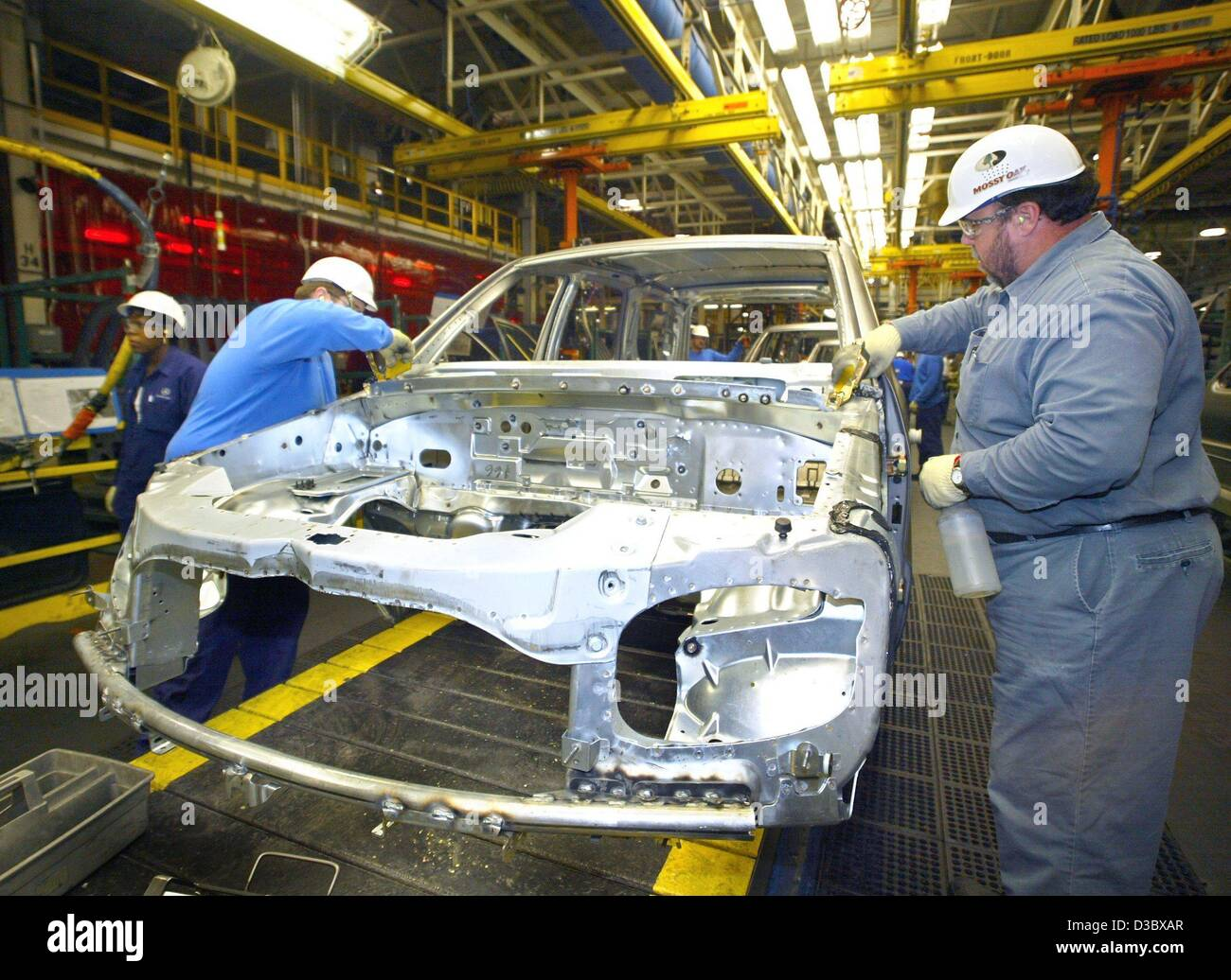 Dpa two workers of daimlerchrysler work on a car body for Mercedes benz manufacturing plant in usa