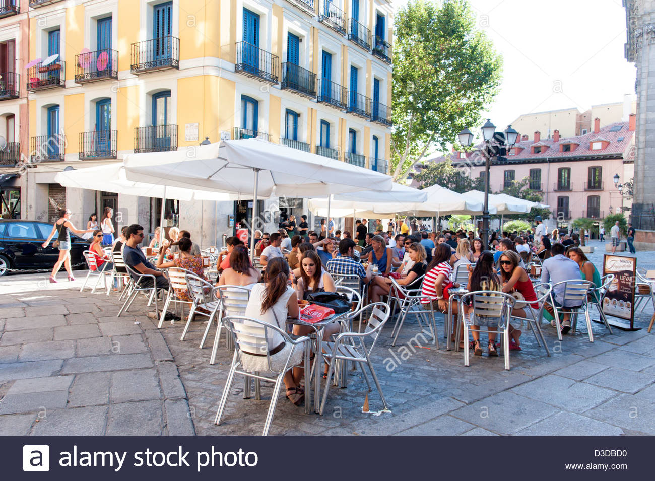 Crowded restaurant table - Crowded Sidewalk Bar Tables In Plaza San Andres La Latina Madrid Spain