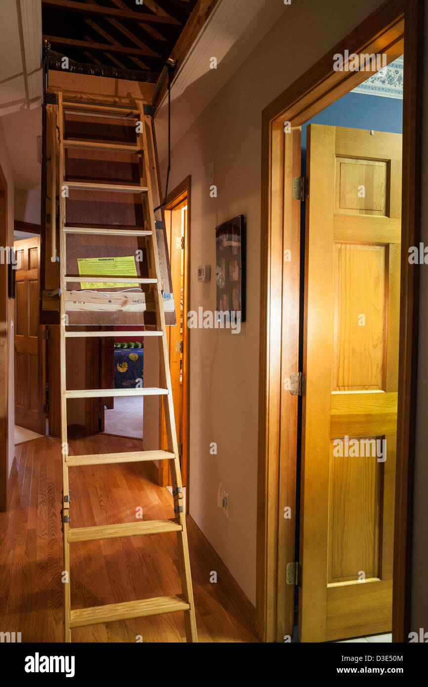 Pull Down Attic Stairs, Trap Door In Hallway Of Upscale Residential House,  USA