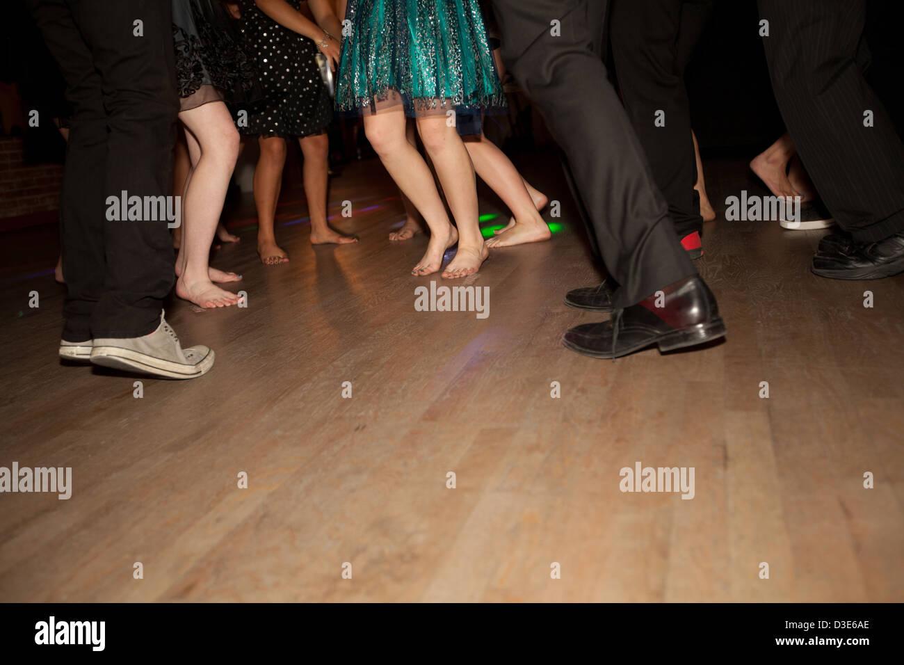 Teenagers feet dancing on wood dance floor high school for 123 get on the dance floor song download