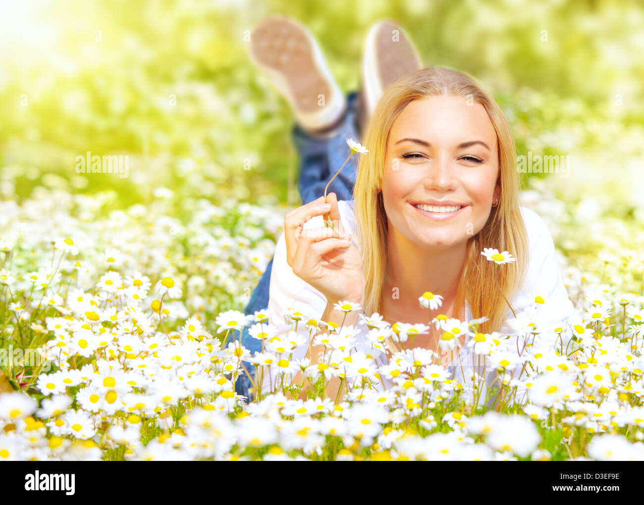 photo of cute blond young lady enjoy beautiful spring nature