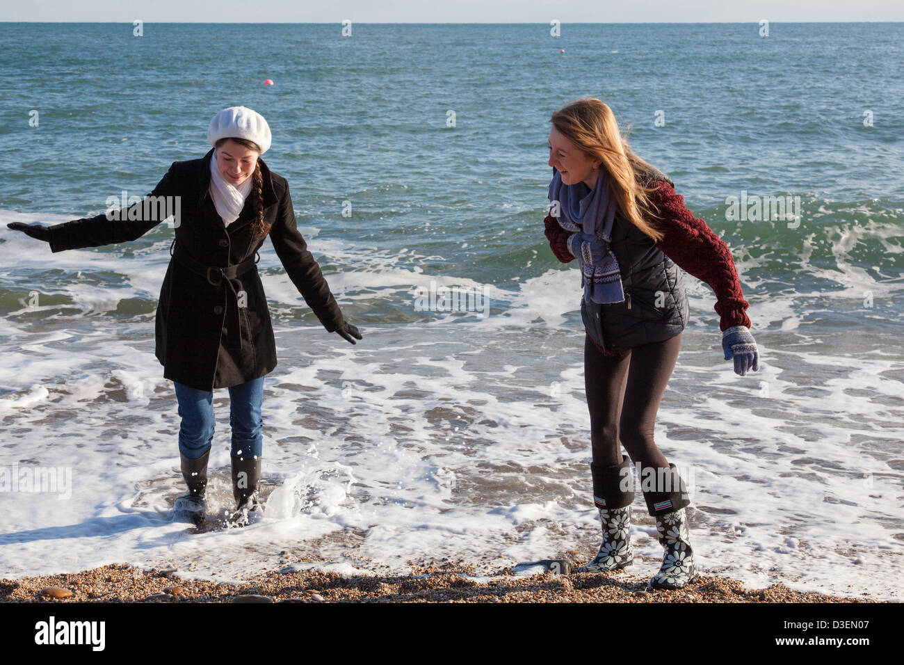 Two girls dressed in coats and wearing wellington boots for Surf fishing waders