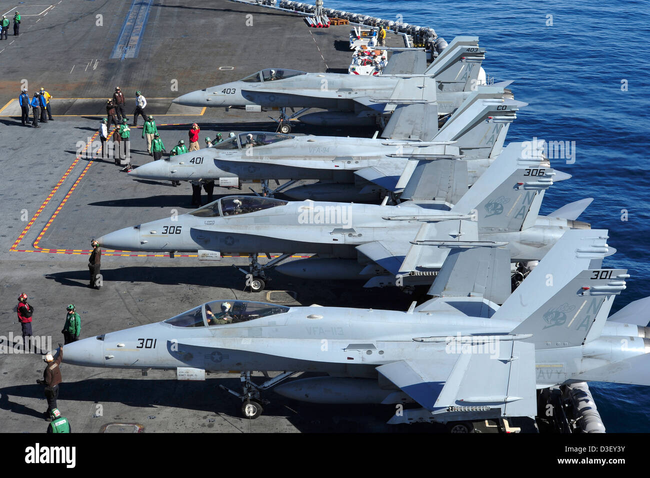 us-navy-fa-18c-hornets-line-up-before-take-off-from-the-us-navy-nimitz-D3EY3Y.jpg