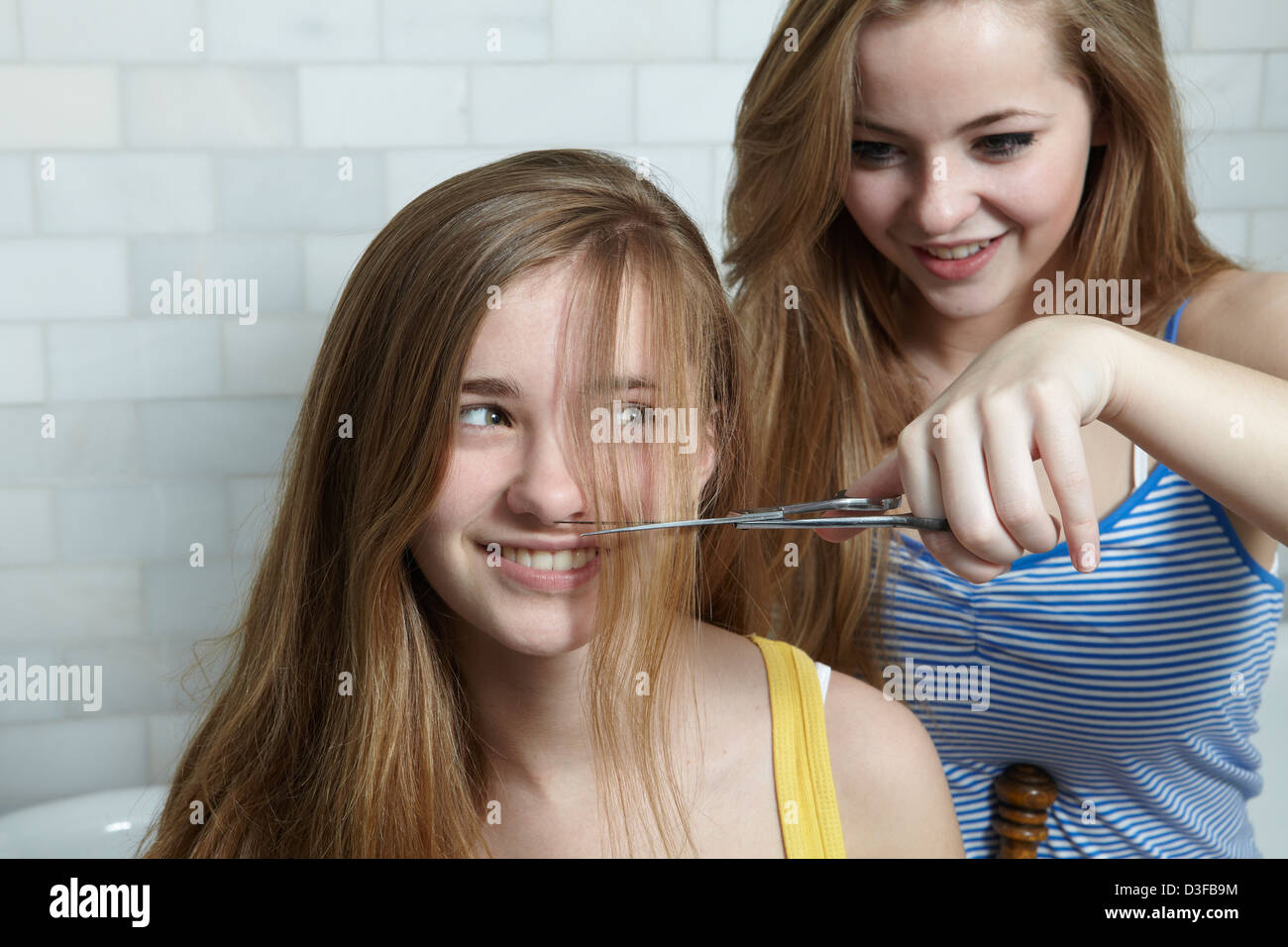 Teen sisters cutting hair stock photo royalty free image stock photo teen sisters cutting hair urmus Choice Image