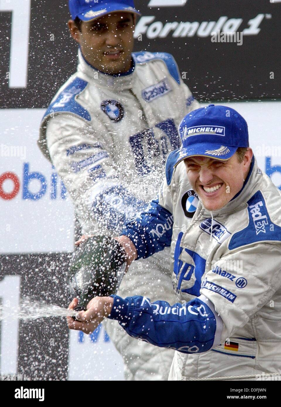 dpa german formula one pilot ralf schumacher front and his teammate colombia s juan pablo montoya both of the team bmw williams celebrate after
