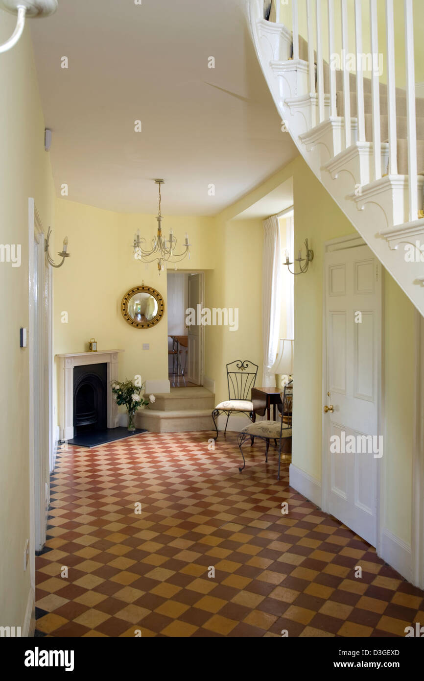 A large victorian style hallway with chequer board pattern floor a large victorian style hallway with chequer board pattern floor tiles dailygadgetfo Gallery