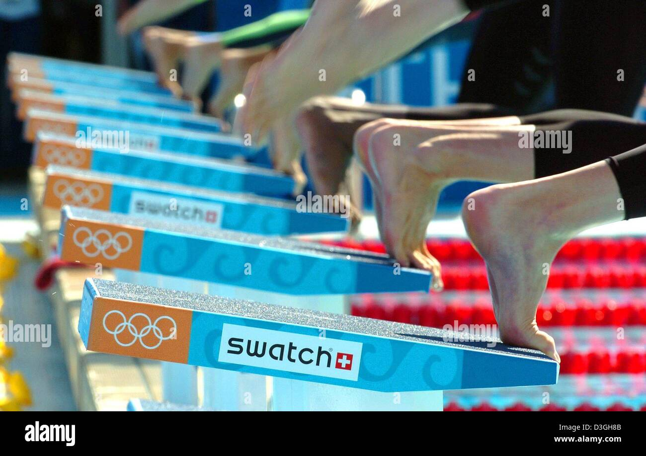 Dpa Swimmers Jump From Their Starting Blocks At The Start Of One Of The  Mens 50m Freestyle Qualifying Heats At The Olympic Aquatic Centre In Athens