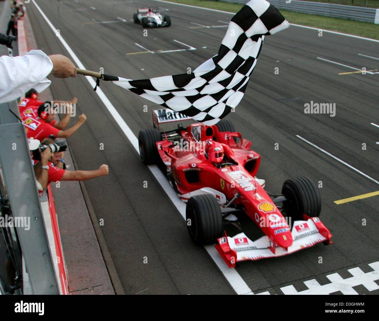 Racing Checkered Flag >> (dpa) - German formula one pilot Michael Schumacher races with his Stock Photo, Royalty Free ...