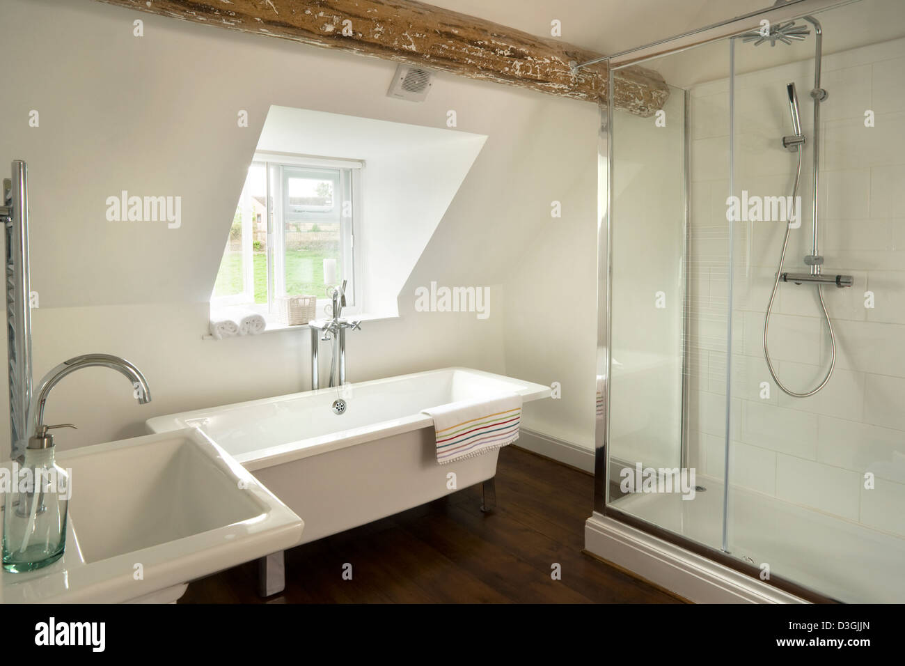 contemporary bathroom with a modern pedestal bath and large built contemporary bathroom with a modern pedestal bath and large built in shower in an attic room