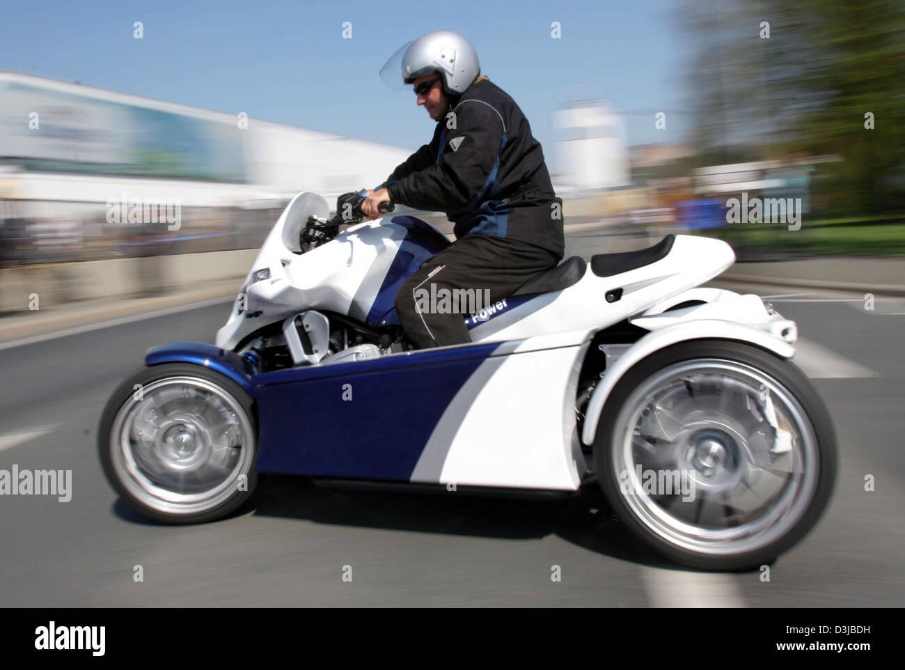 Dpa A Four Wheel Motor Bike Quad Crosses A Street In Kulmbach