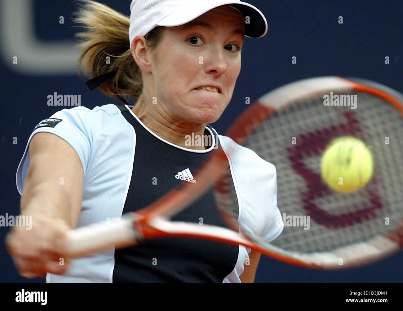 dpa Belgian tennis pro Justine Henin Hardenne looks exerted