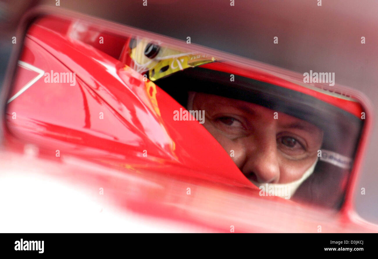 dpa) - Jean Todt (L) team leader of Ferrari looks at German ...