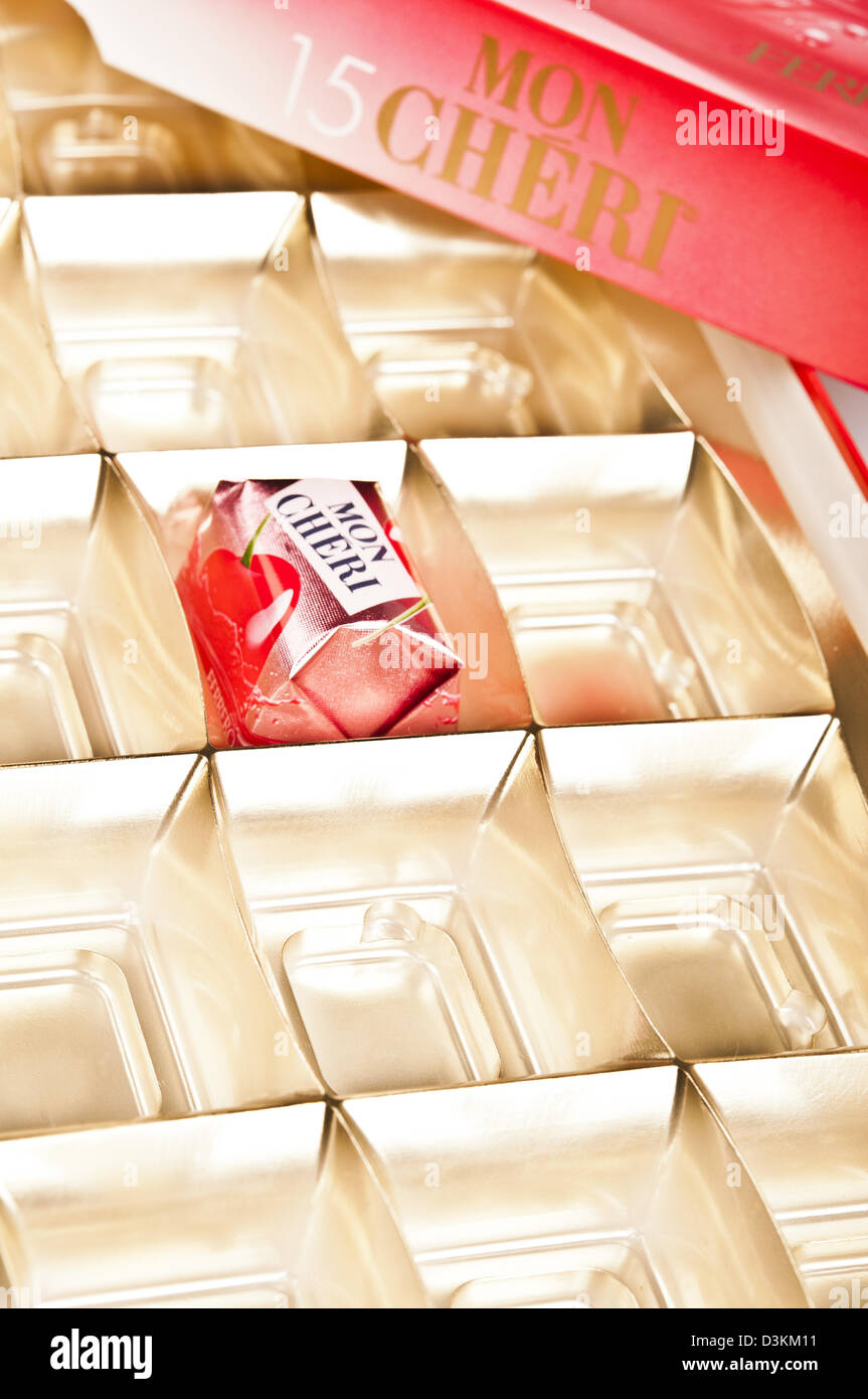 Mon Cheri chocolate box with one bonbons remained Stock Photo ...