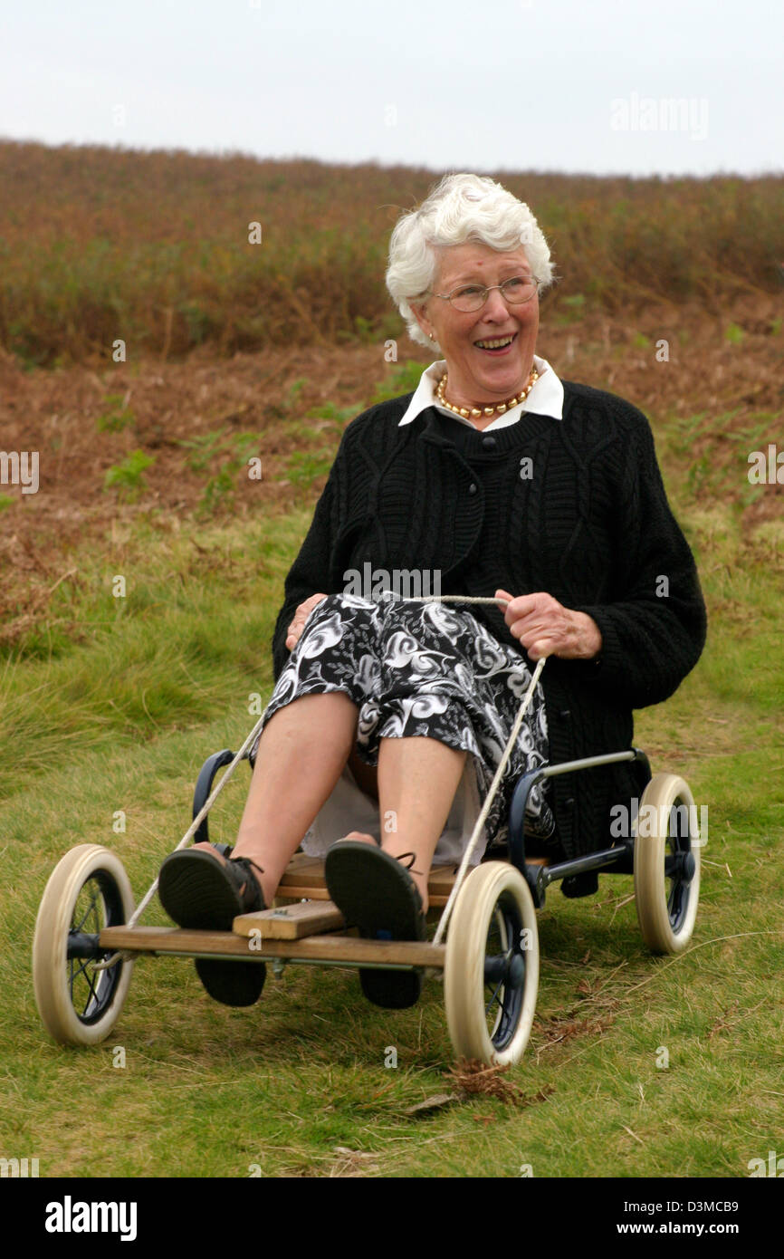 elderly lady pensioner 75 year old laughing on a gokart Stock ...