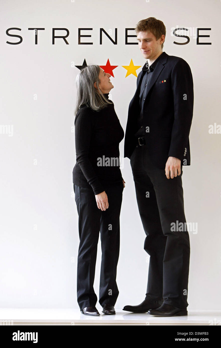 Stock Photo - Fashion designer Gabriele Strehle looks up to German national soccer player Per Mertesacker wearing the German national soccer team's official suit for the 2006 World Cup. The
