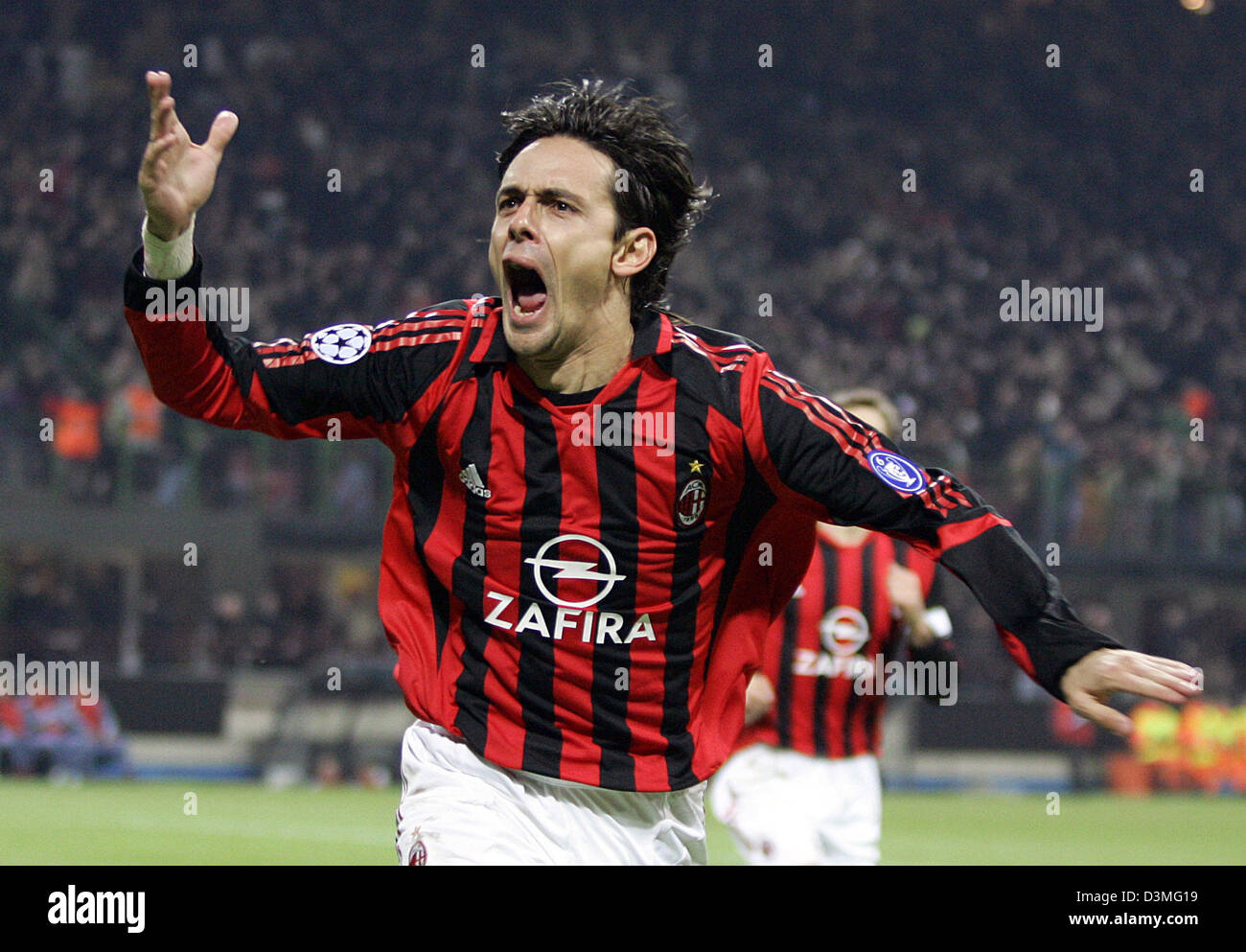 AC Milan s Filippo Inzaghi celebrates his second goal against FC