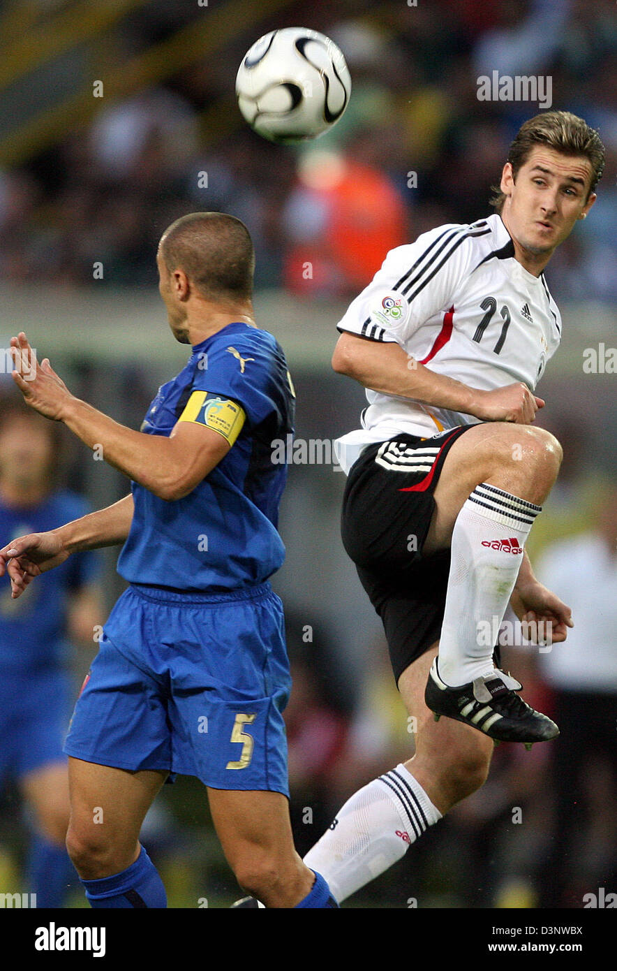 Miroslav Klose R from Germany vies with Fabio Cannavaro L from