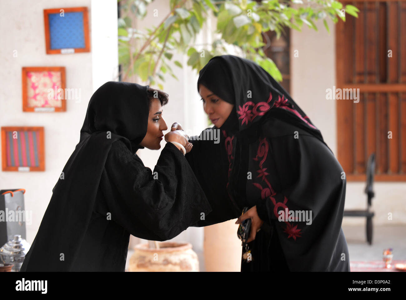 Two arab women greet each other with a suggest kiss on the hand two arab women greet each other with a suggest kiss on the hand kristyandbryce Choice Image