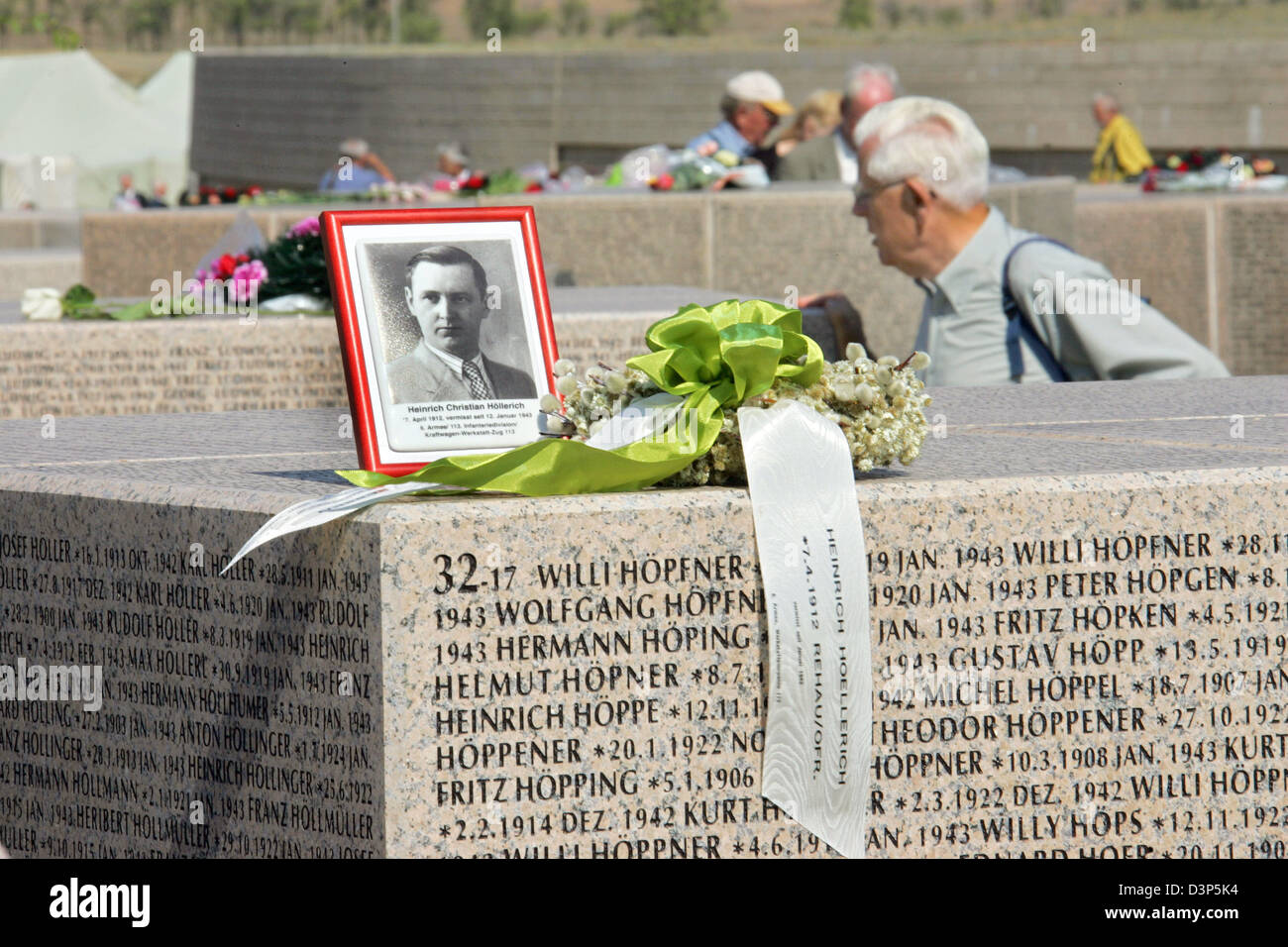 A Photo Of A Missing German Soldier Stands On A Granite
