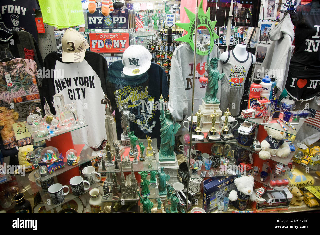 Tourist souvenirs on sale in a shop window in new york for Gifts for new yorkers
