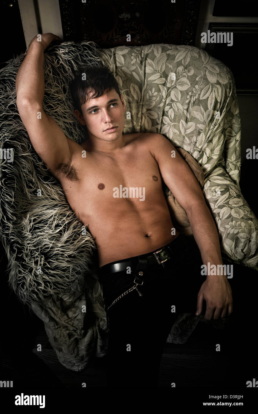 Shirtless man lying on couch Stock Photo, Royalty Free Image ...