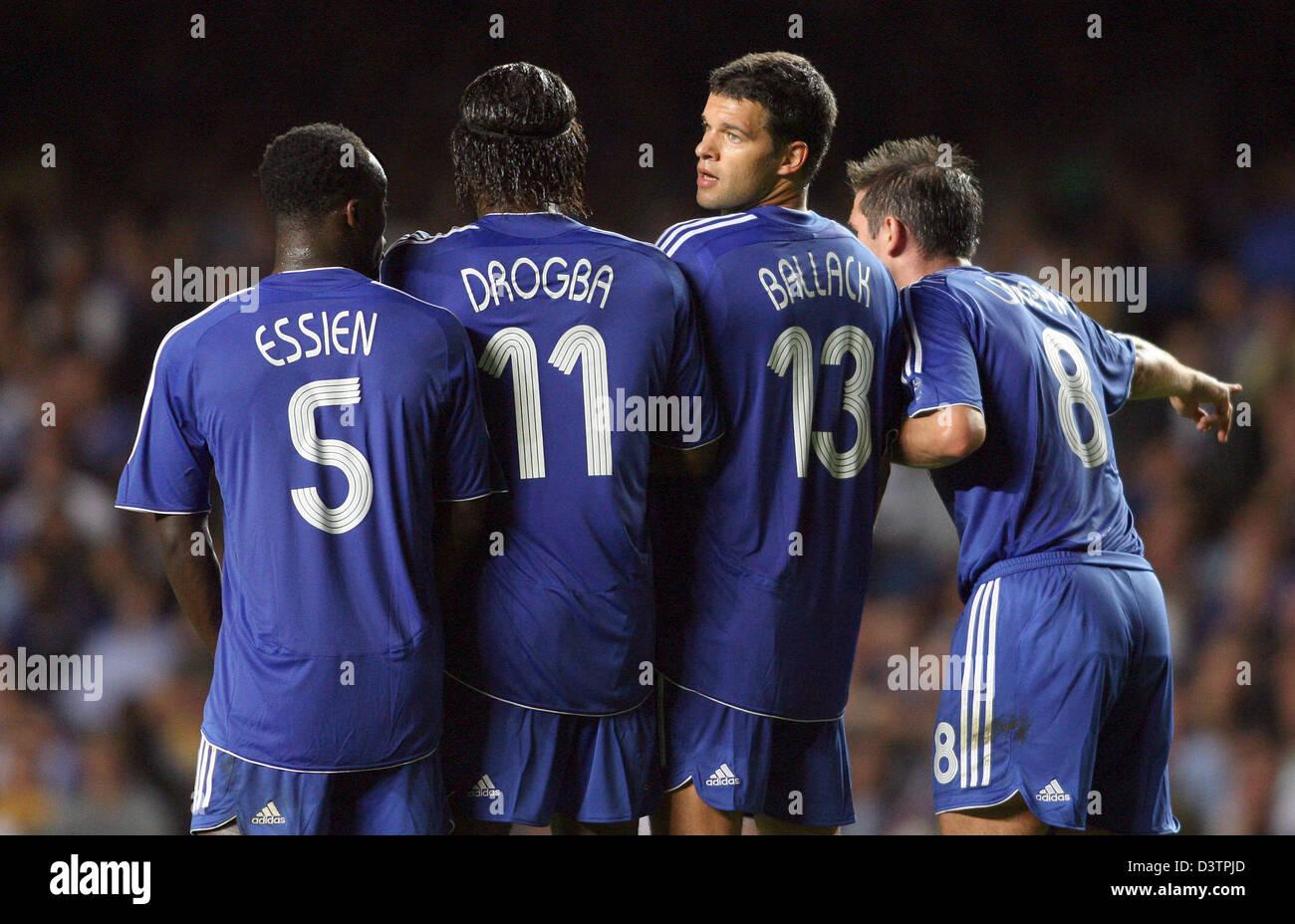 Chelsea players L R Michael Essien Di r Drogba Michael