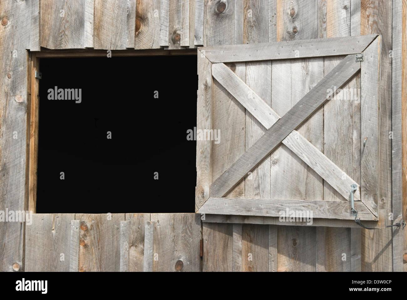 Open Barn Door barn door open to black background as a design element, a dutch
