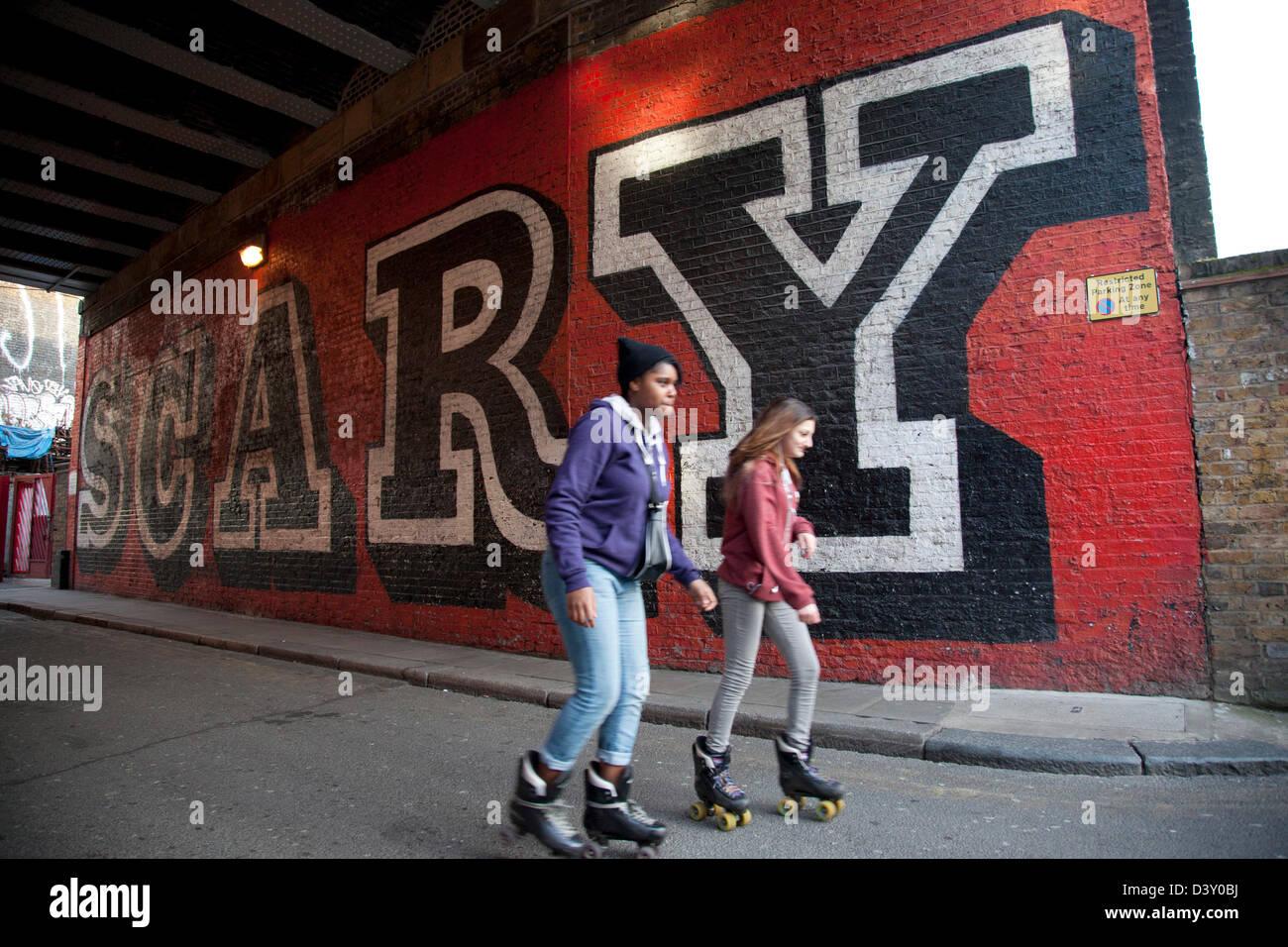 Sidewalk sport lane roller skate shoes - Urban Girls Rollerskate Past The Scary Street Art Mural By Ben Eine In Shoreditch East
