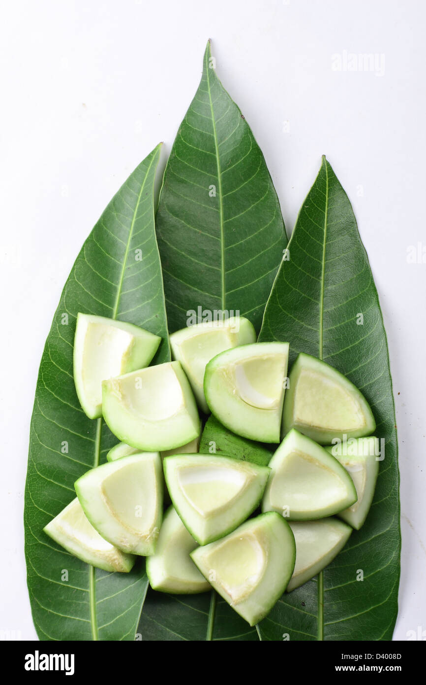 raw cut mango on mango leaves Stock Photo: 54089965 - Alamy