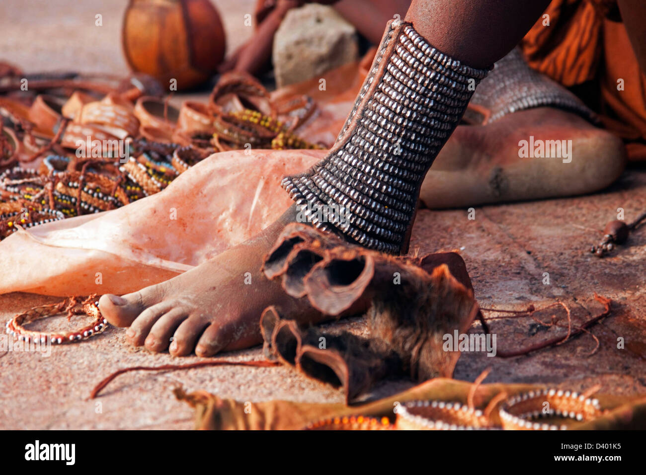 Close up of woman's feet decorated with anklets and ...