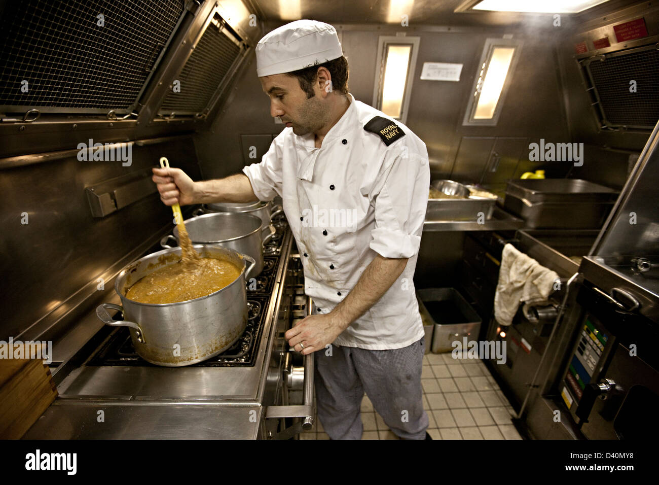 Chef Working In Kitchen Of Nuclear Submarine Hms Talent