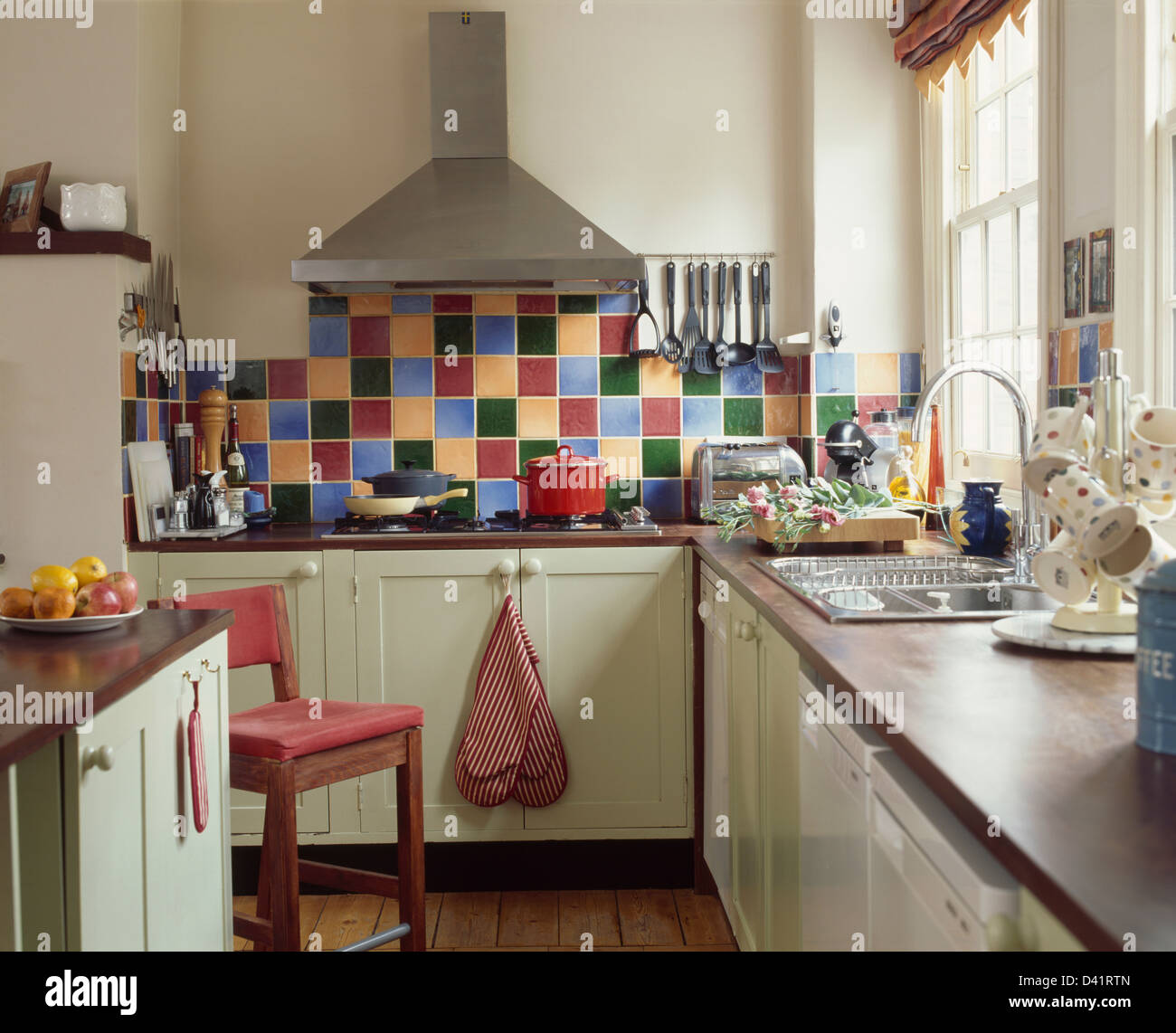 Stainless Steel Extractor And Multi Colored Tiled Splash