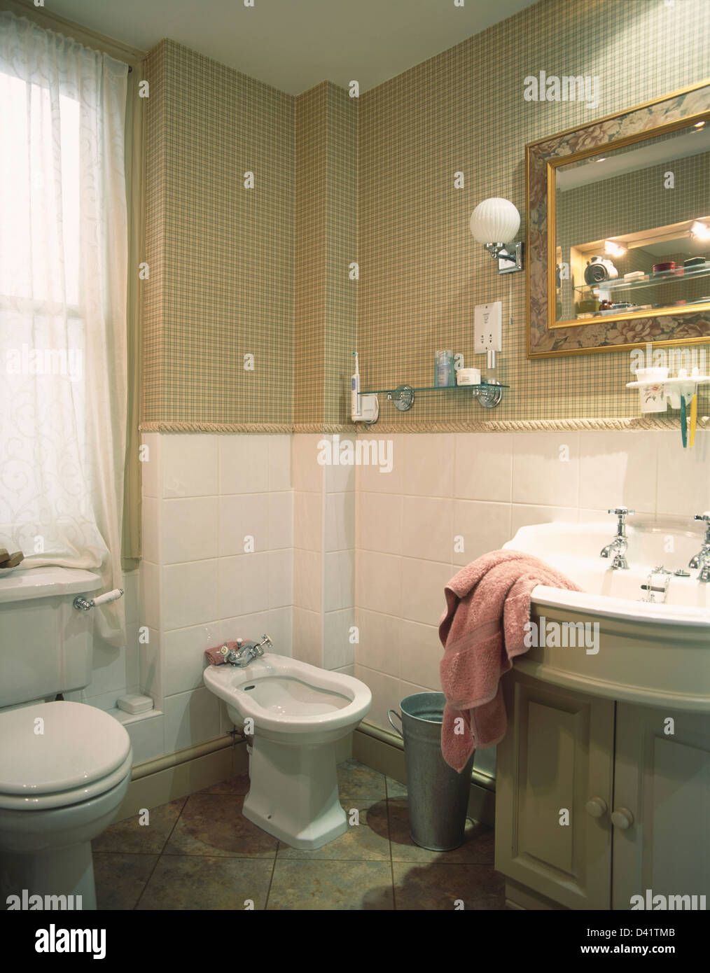 white tiled wall with beige checked wallpaper above dado