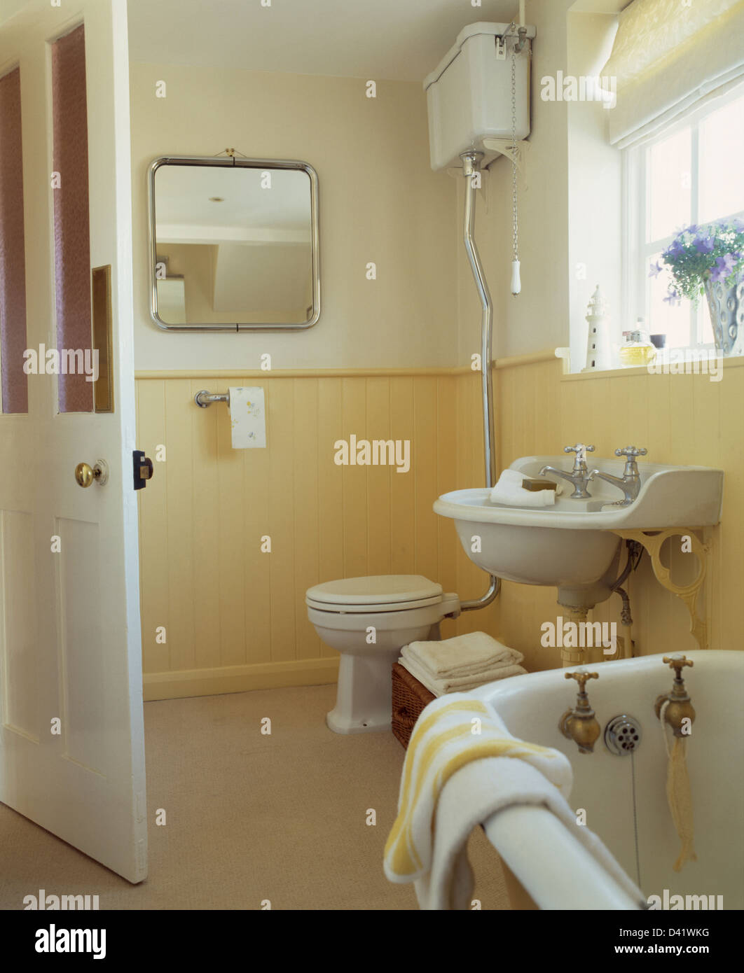 Tongue and groove for bathrooms - Metal Framed Mirror And Yellow Tongue Groove Paneling To Dado Height Traditional In Townhouse