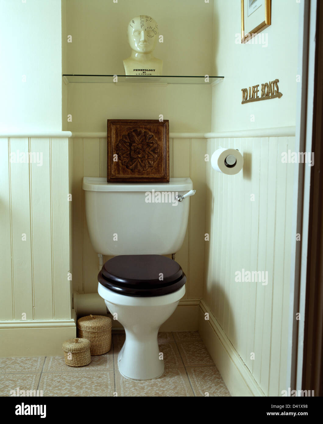 Tongue and groove for bathrooms -  Phrenology Head On Glass Shelf Above Toilet With Wooden Carving On Cistern In Tongue Groove